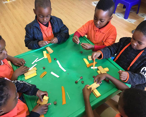 Children creating a healthy snack