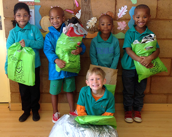 Children with Mpact recycling bags