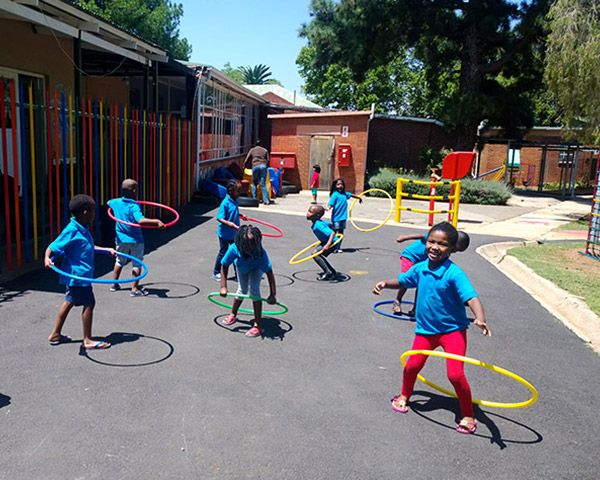 Playing with hoola hoops at Treasure Tots Modderfontein